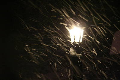 Blowing Snow Against Lamp Art Print by Carolyn Reinhart