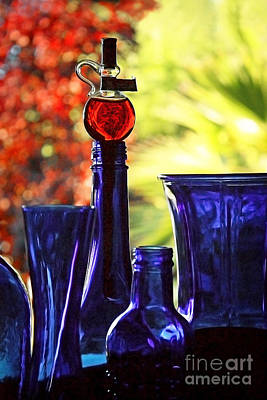 Photograph - Blue Bottles In Autumn by Ellen Cotton