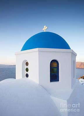 Blue Domed Church In Oia Santorini Greece Print by Matteo Colombo