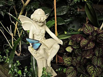 Blue Morpho On Statue Art Print