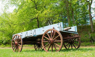 Wagon Wheel Hub Wall Art - Photograph - Blue Pioneer Wagon by Douglas Barnett