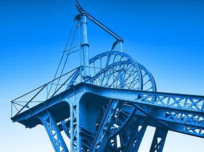 Blue Winding Wheels Art Print by John Lynch