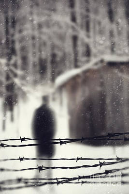 Photograph - Blurred Figure Behind Barbed Wire Fence by Sandra Cunningham