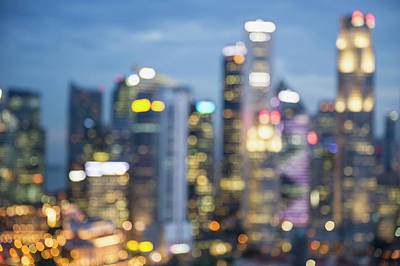 Blurred View Of City Skyline Lit Up At Art Print by Jacobs Stock Photography Ltd