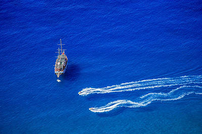 Photograph - Boat And Jet Skis by Ali Kabas