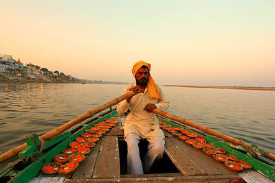 Cremation Ghat Photograph - Boat Man On The Ganges River At Varanasi by Amanda Stadther