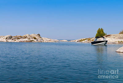 Boat Photograph - Boat On A Blue Lake by Les Palenik