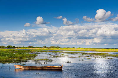 Landscapes Royalty-Free and Rights-Managed Images - wooden boat in Biebrza wetland area landscape  by Arletta Cwalina
