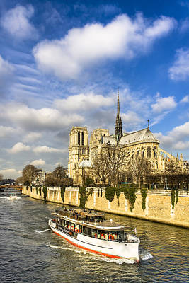Architecture Photograph - Boat Passing Notre Dame De Paris  by Mark E Tisdale
