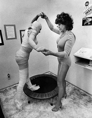 Helping Photograph - Body Wrap Exercise by Underwood Archives