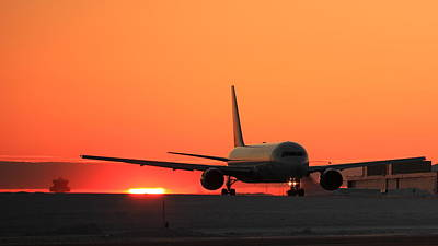 Transportation Photograph - Boeing 767 Taxiing At Sunset by Andrei Filippov