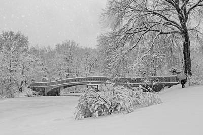 Photograph - Bow Bridge In Central Park During Snowstorm Bw by Susan Candelario