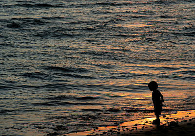 Photograph - Boy At Sunset by John Orsbun