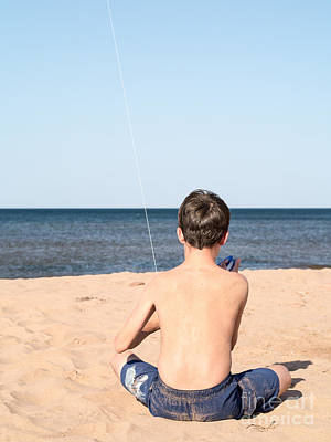 Kite Photograph - Boy At The Beach Flying A Kite by Edward Fielding