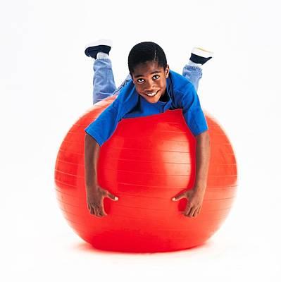 9 Ball Photograph - Boy Balancing On Exercise Ball by Ron Nickel