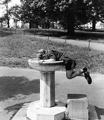 Fountain Photograph - Boy Drinking From Fountain by Underwood Archives