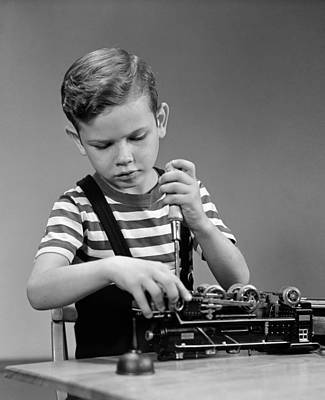 Tinker Toy Photograph - Boy Fixing Toy Train, C.1930-40s by H. Armstrong Roberts/ClassicStock