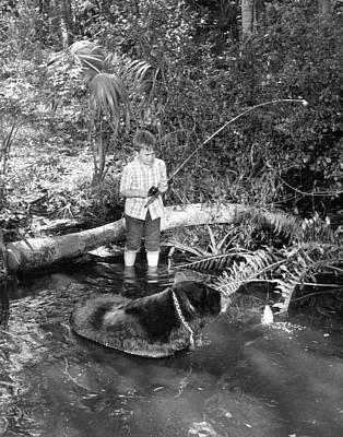 Boy Has A Unique Fishing Partner Art Print by Retro Images Archive