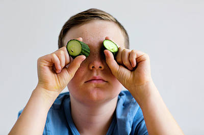 Obscured Face Photograph - Boy Holding Cucumber Over Eyes by Gombert, Sigrid
