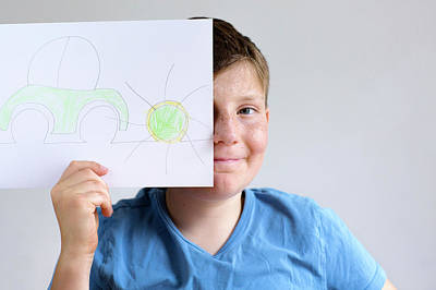 Obscured Face Photograph - Boy Holding Drawing Of Car And Sun by Gombert, Sigrid