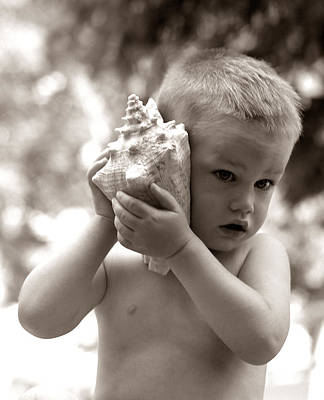 Photograph - Boy Holding Seashell To Ear, C.1960s by H Armstrong Roberts and ClassicStock