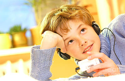 Learning Photograph - Boy Listen To Music by Michal Bednarek