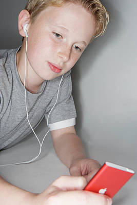Boy Listening To Music Art Print by Gustoimages/science Photo Library