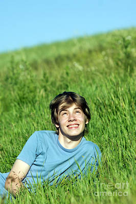 Education Photograph - Boy Lying On The Fresh Green Grass by Michal Bednarek