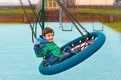 Child Swinging Photograph - Boy On Swing by Tom Gowanlock