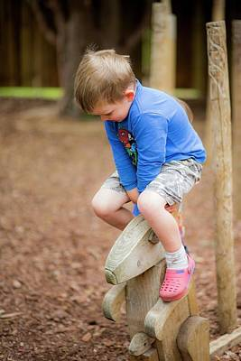 Boy Playing In The Park Art Print by Samuel Ashfield