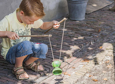 Fun Pastimes Photograph - Boy Playing With A Diabolo by Patricia Hofmeester