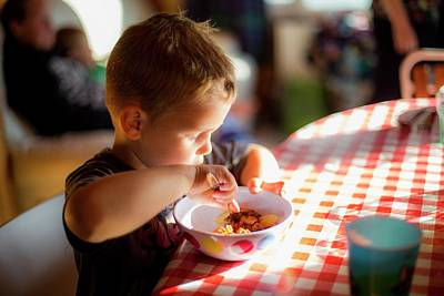 Boy Sitting At Table Eating A Meal Art Print