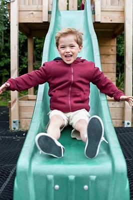 Boy Sliding Down A Slide Art Print by Ian Hooton