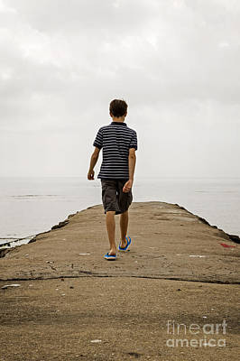 Photograph - Boy Walking On Concrete Beach Pier by Edward Fielding