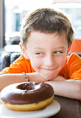 Boy With Donut Art Print by Tom Gowanlock