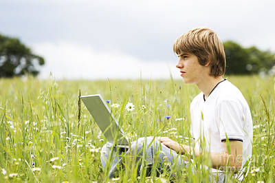 Sitting Photograph - Boy With Notebook On The Field by Michal Bednarek