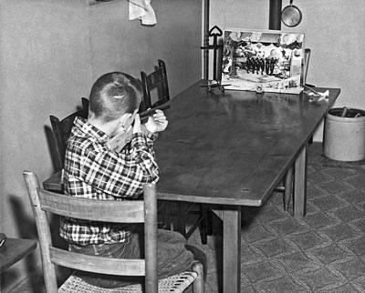 Boy With Shooting Game Art Print by Underwood Archives