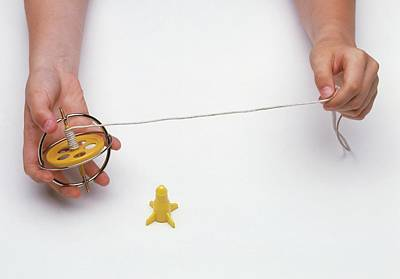 Hands Images Photograph - Boy's Hands Holding Gyroscope With String by Dorling Kindersley/uig