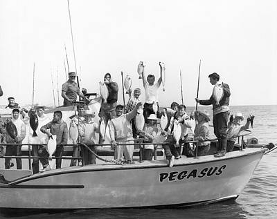 Pegasus Photograph - Boys Hold Up Their Fish by Underwood Archives