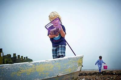 Boys Playing On Beach With Fishing Net Art Print