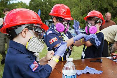 Boy Scouts Photograph - Boys Trying On Protective Equipment by Jim West