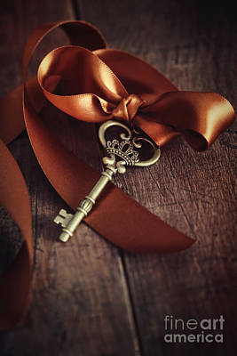 Photograph - Brass Key With Satin Ribbon On Wood by Sandra Cunningham
