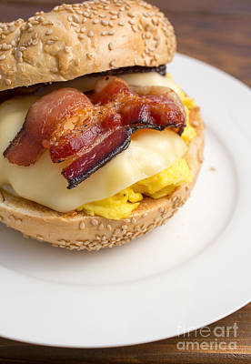 Food Stores Photograph - Breakfast Sandwich Of Bacon Egg Cheese On A Bagel by Edward Fielding