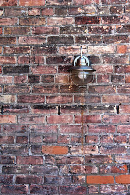 Photograph - Brick Wall And Metal Lamp by Mary Bedy