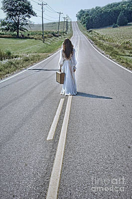Bride Walking With Suitcase On Country Road Art Print by Jill Battaglia