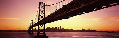 Evening Scenes Photograph - Bridge Across A Bay With City Skyline by Panoramic Images
