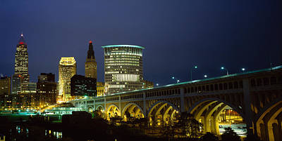 Cuyahoga Photograph - Bridge In A City Lit Up At Night by Panoramic Images