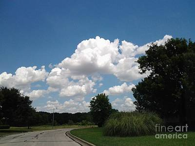 Photograph - Brilliant Clouds by Susan Williams