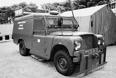 British Army Armoured Land Rover At Grey Point Fort Helens Bay County Down Northern Ireland Art Print by Joe Fox