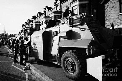 British Army Armoured Saxon Personnel Carrier Vehicle On Crumlin Road At Ardoyne Shops Belfast 12th  Art Print
